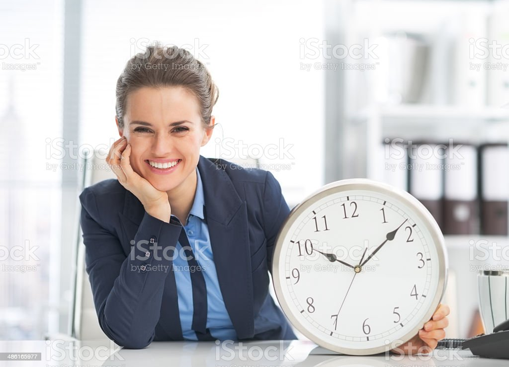 happy business woman showing clock stock photo