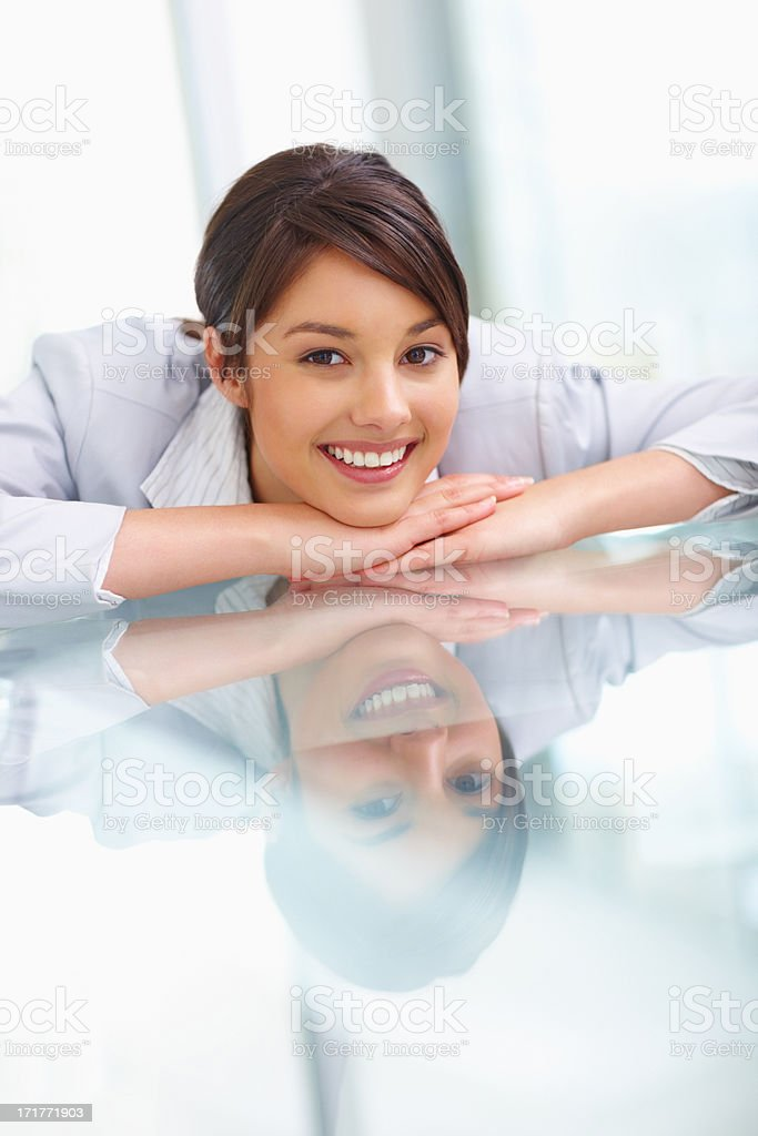 Happy business woman sitting relaxed at a table stock photo
