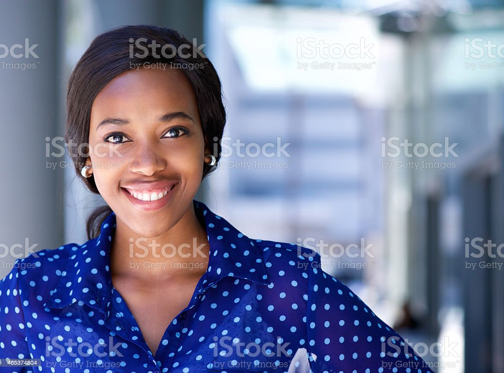 Happy business woman smiling outside office building stock photo
