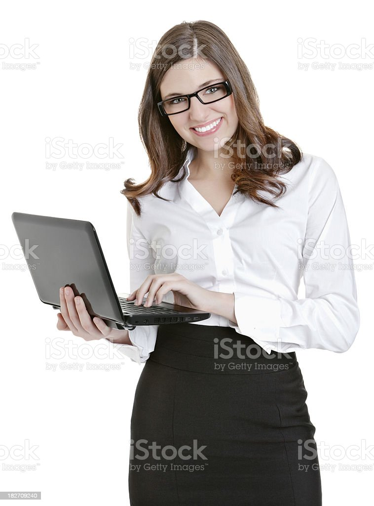 Happy business woman using on a laptop against white royalty-free stock photo