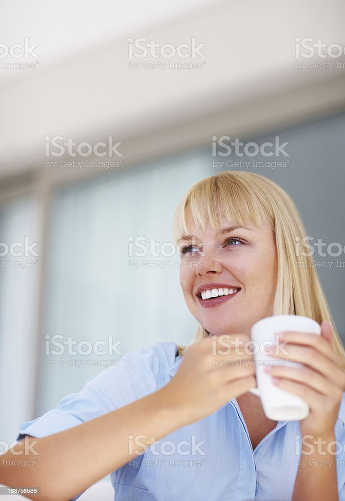 Happy business woman with coffee cup royalty-free stock photo