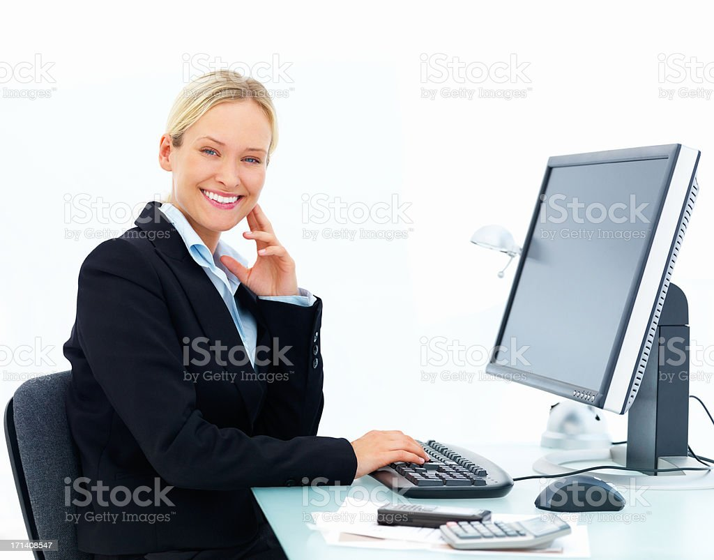Happy business woman working on a computer isolated at white background royalty-free stock photo