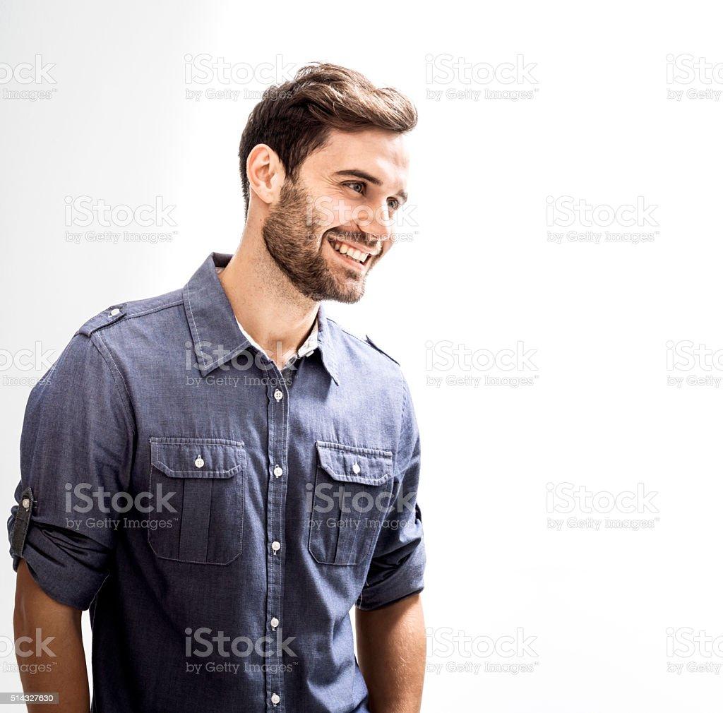 Happy businessman against white background stock photo