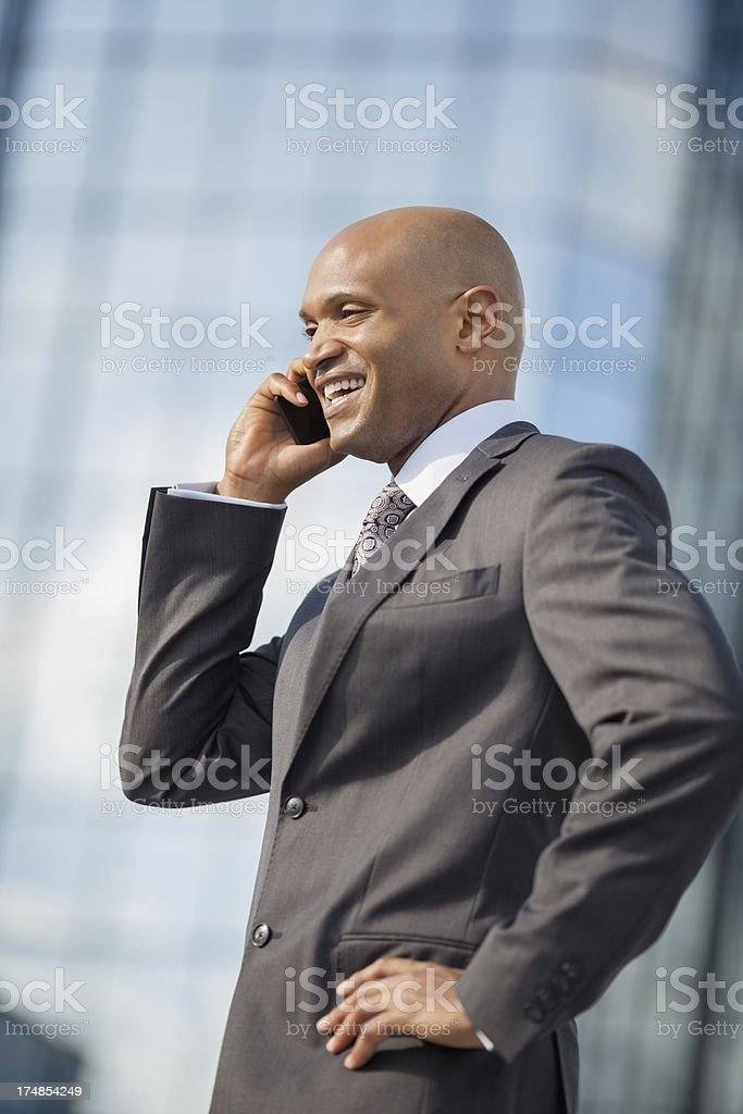 Happy Businessman Answering Phone Call royalty-free stock photo