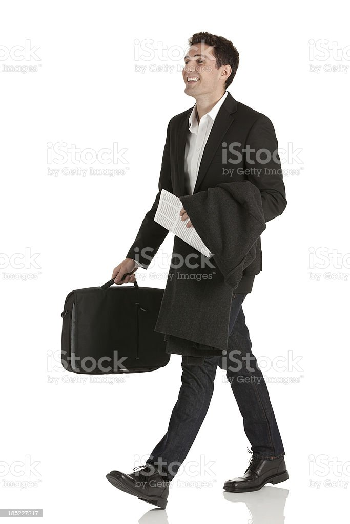 Happy businessman carrying a suitcase royalty-free stock photo