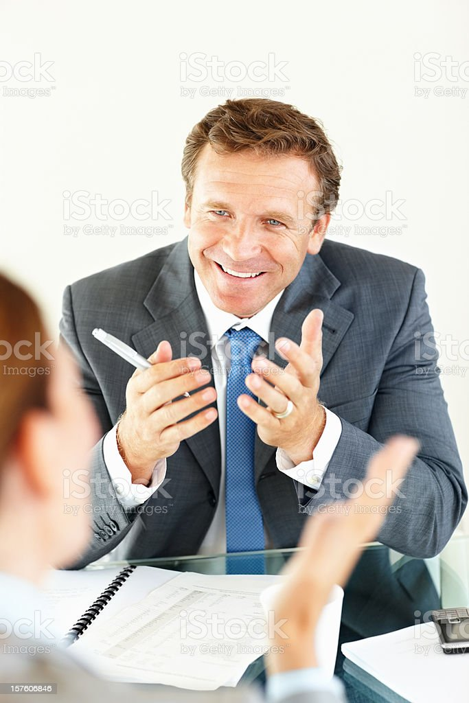 Happy businessman discussing with his colleague royalty-free stock photo