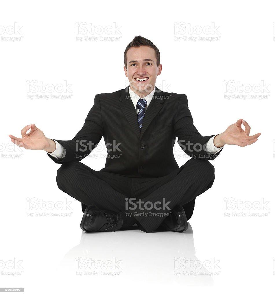 Happy businessman doing yoga royalty-free stock photo