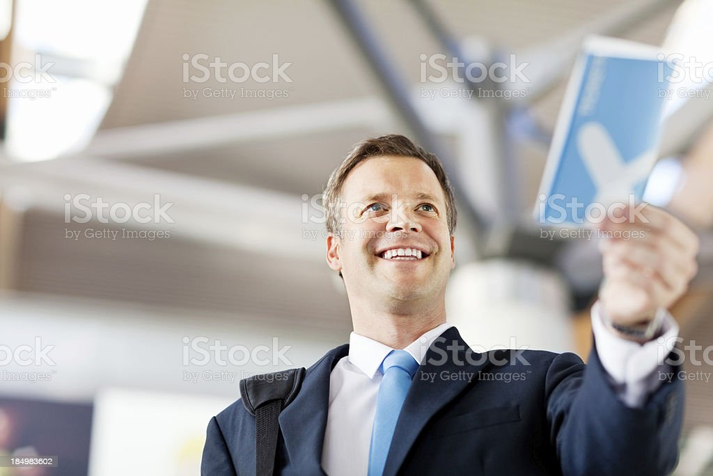 Happy Businessman Handing Over His Flight Tckets royalty-free stock photo