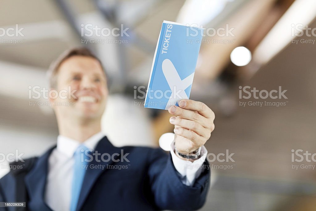 Happy Businessman Handing Over His Flight Tckets royalty-free stock photo