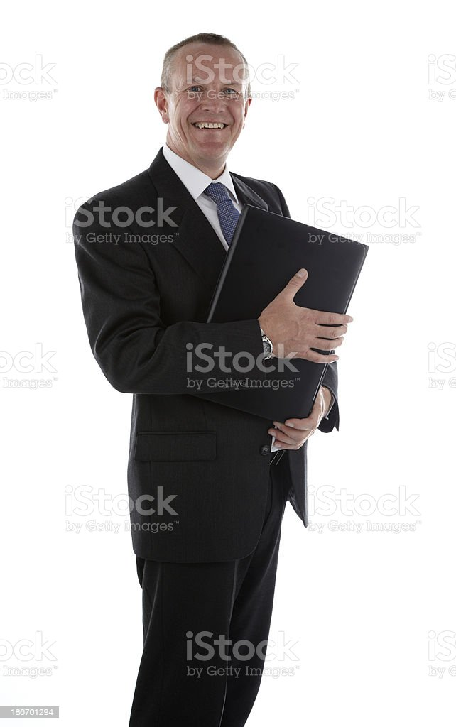 Happy businessman holding laptop royalty-free stock photo