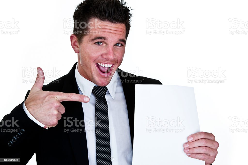 Happy businessman holding paper for copy space royalty-free stock photo
