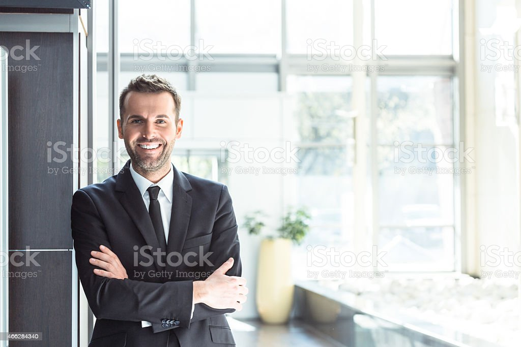 Happy businessman in an office stock photo