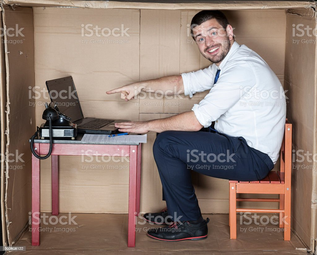 happy businessman in his corporate office stock photo