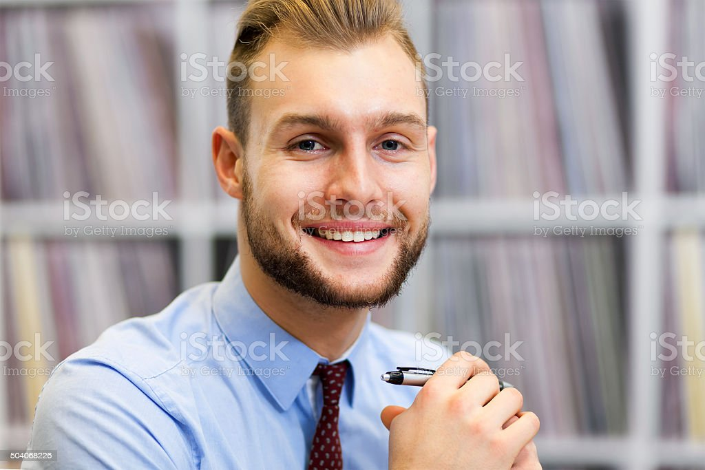 Happy businessman in his studio stock photo