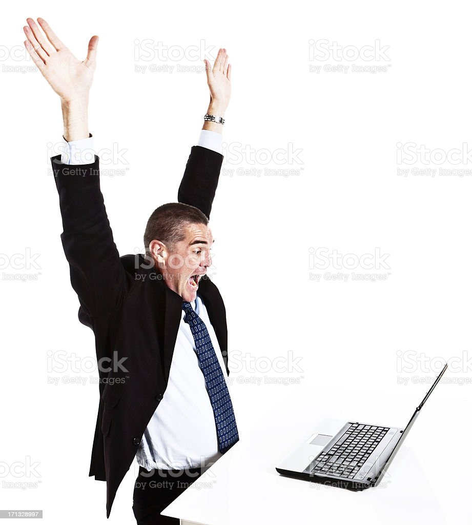 Happy businessman is delighted by something on his laptop stock photo