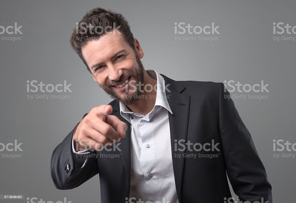 Happy businessman laughing and pointing finger stock photo
