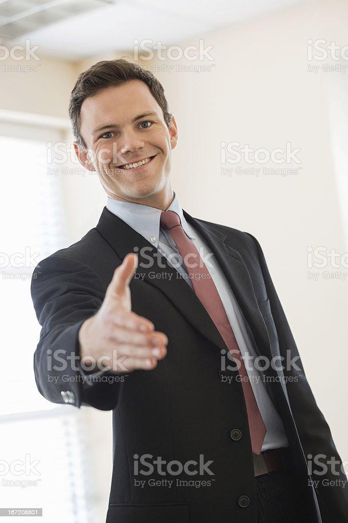 Happy Businessman Offering Handshake royalty-free stock photo