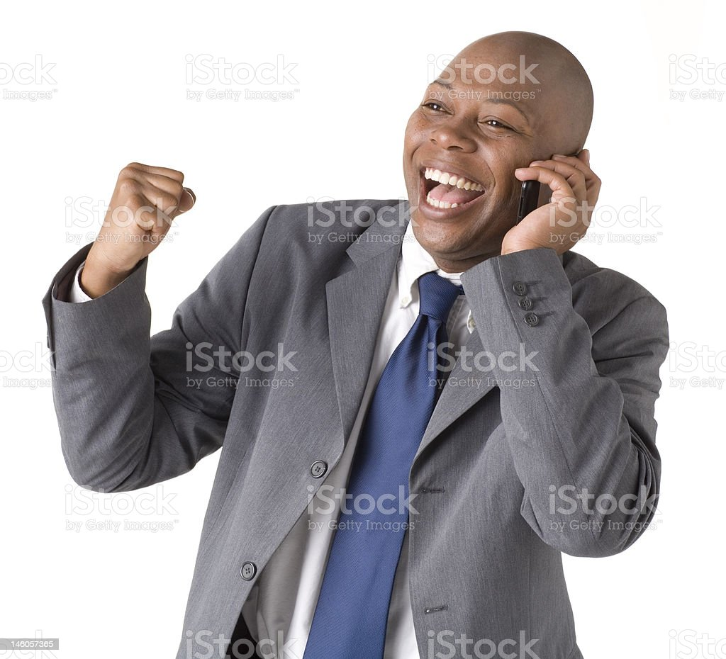 Happy businessman on cell phone royalty-free stock photo