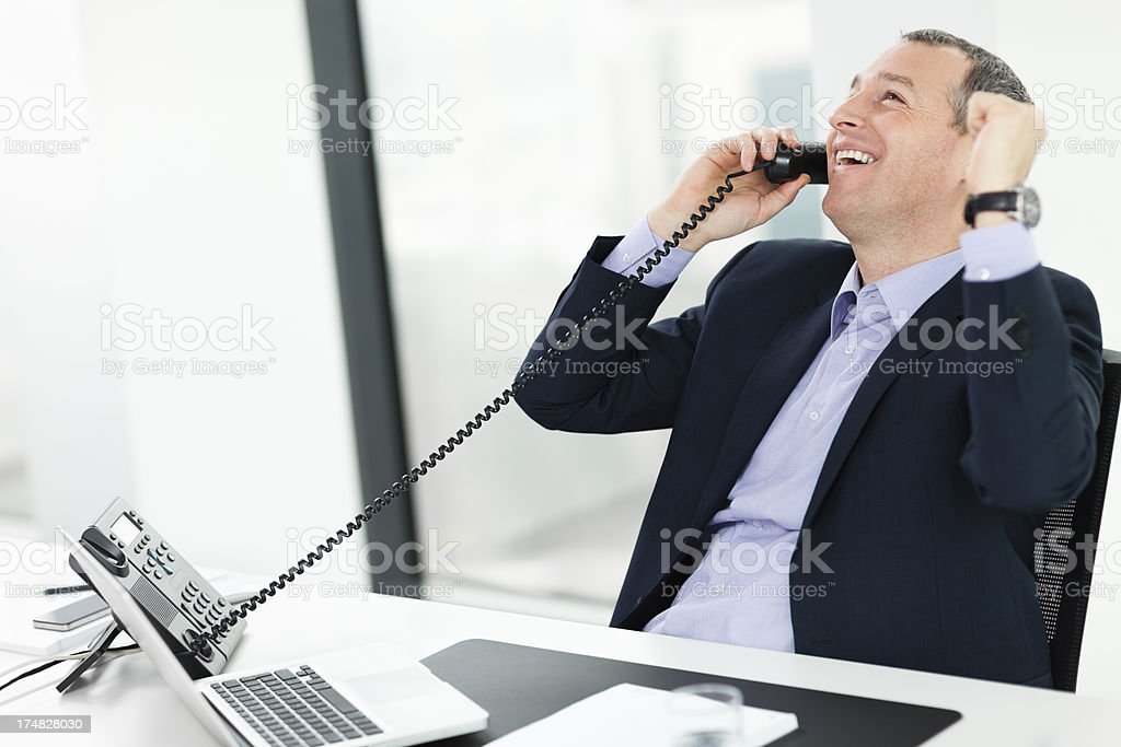 Happy businessman on the phone royalty-free stock photo