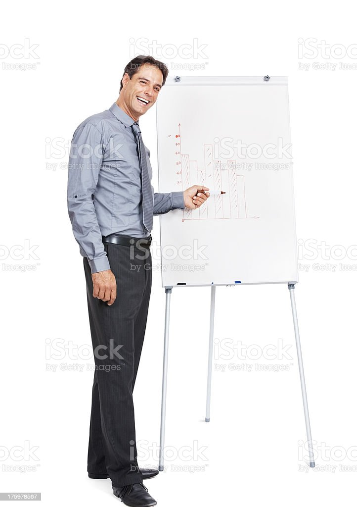 Happy businessman presenting growth on a whiteboard stock photo