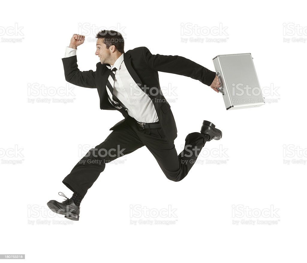 Happy businessman running with a briefcase royalty-free stock photo