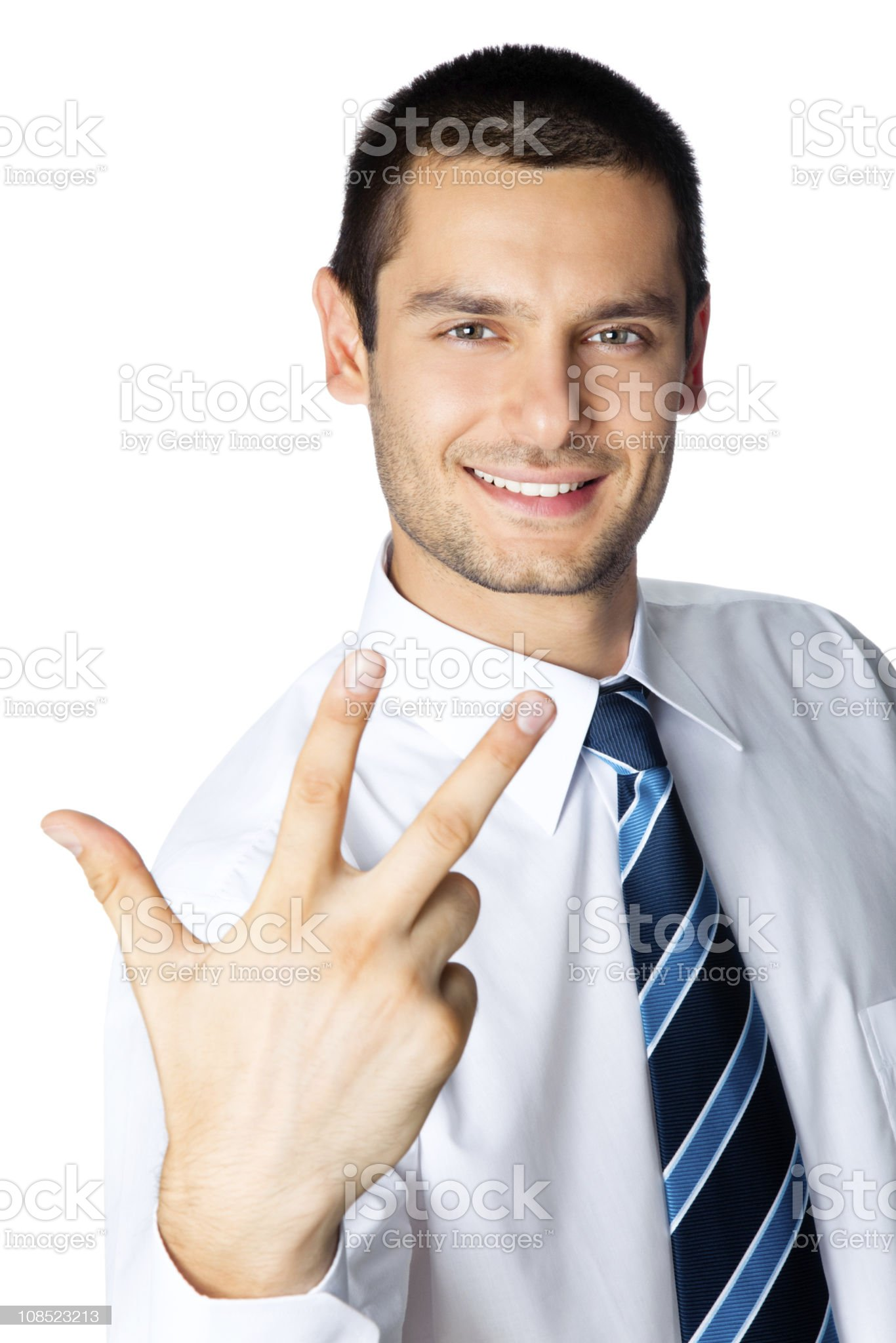 Happy businessman showing three fingers, isolated on white royalty-free stock photo
