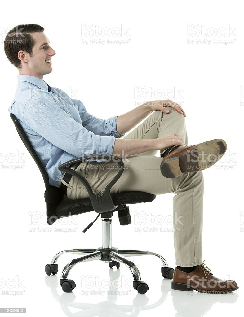 Happy businessman sitting in a chair royalty-free stock photo