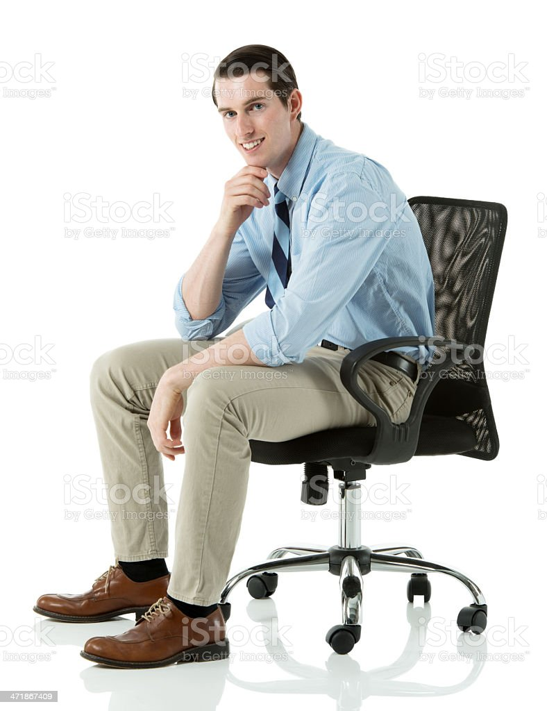 Happy businessman sitting on a chair royalty-free stock photo