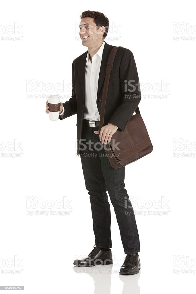 Happy businessman standing with a disposable cup royalty-free stock photo