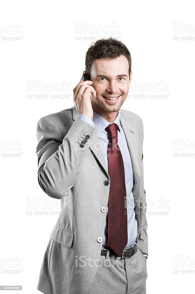 Happy businessman talking on mobile royalty-free stock photo