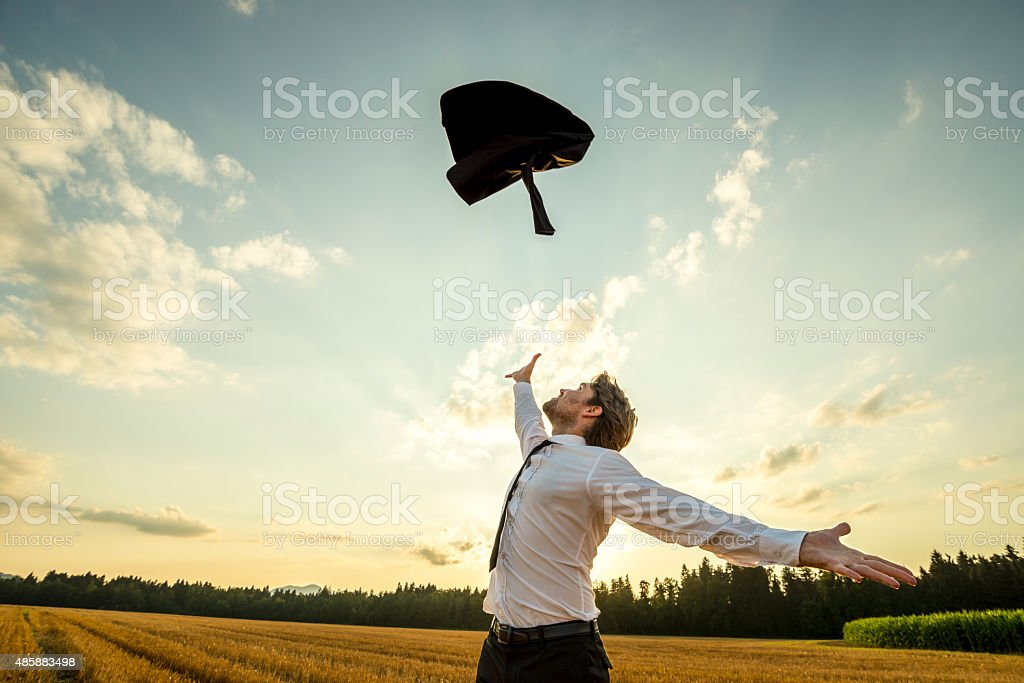Happy Businessman Throwing his Coat for being Free stock photo