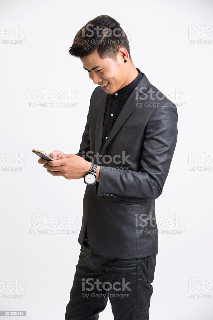 Happy businessman using mobile phone stock photo
