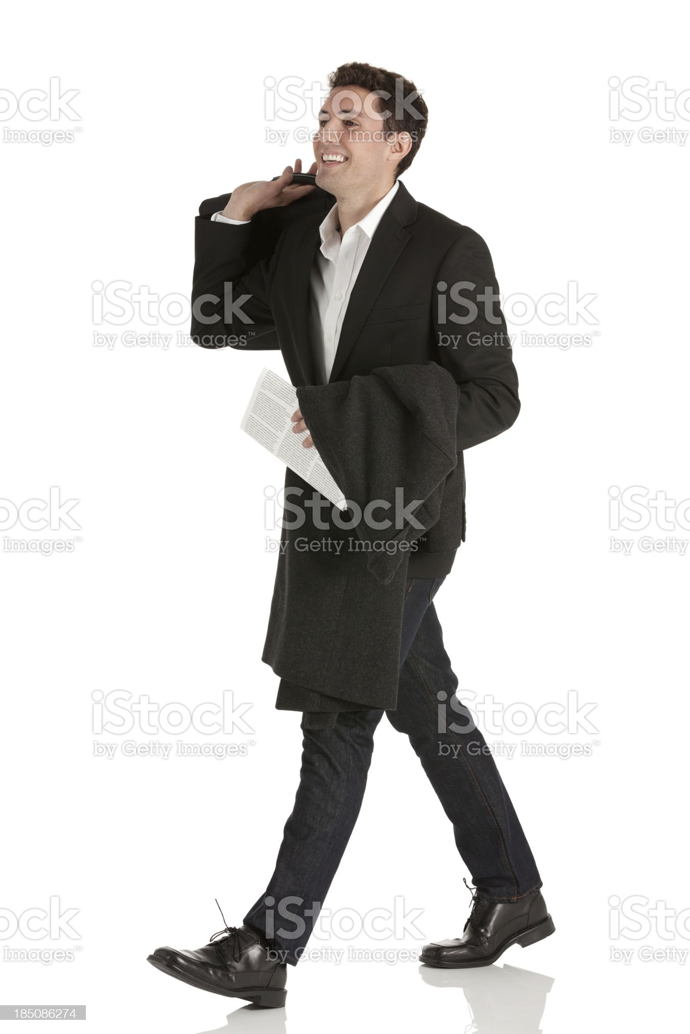 Happy businessman walking royalty-free stock photo