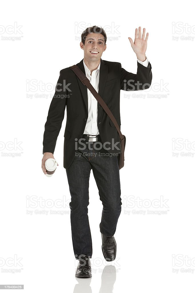 Happy businessman waving his hand royalty-free stock photo