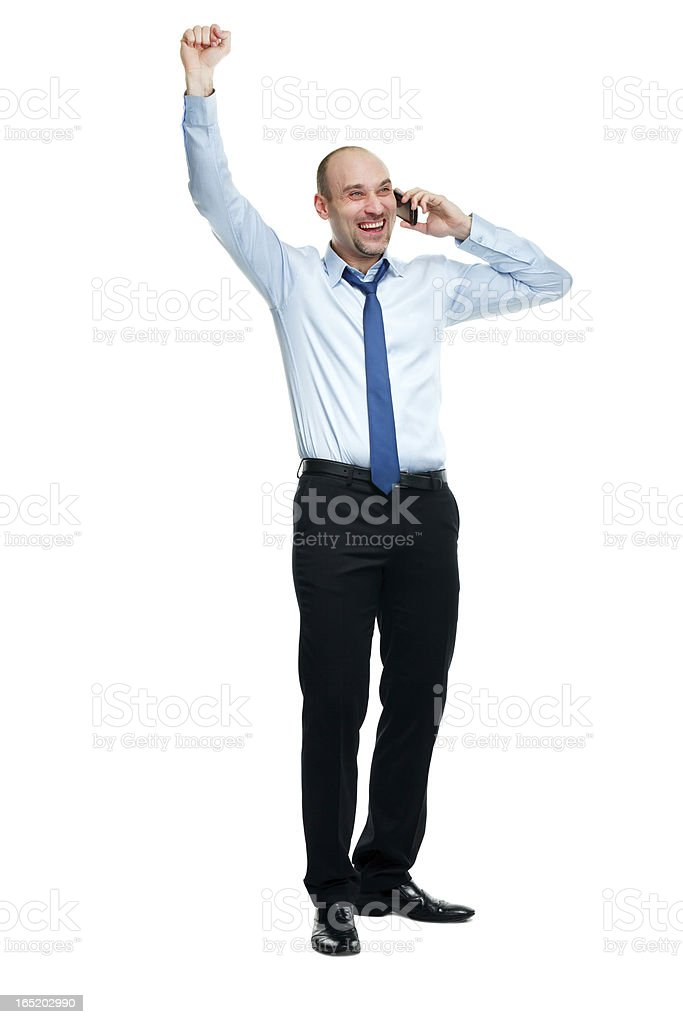 Happy businessman winning while talking on the phone royalty-free stock photo
