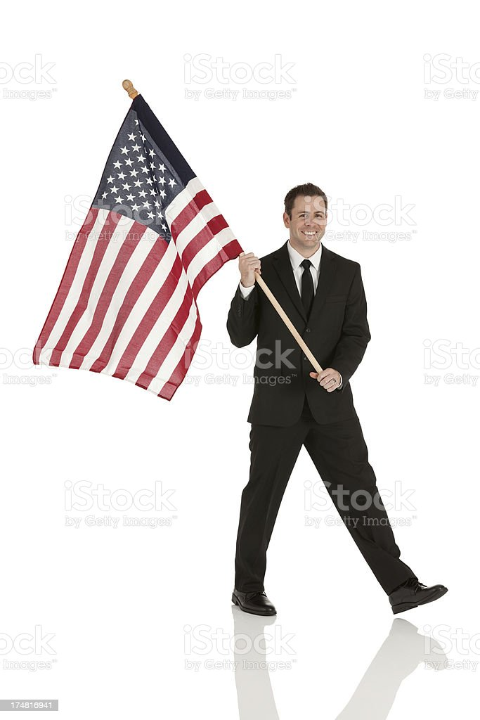 Happy businessman with American flag royalty-free stock photo