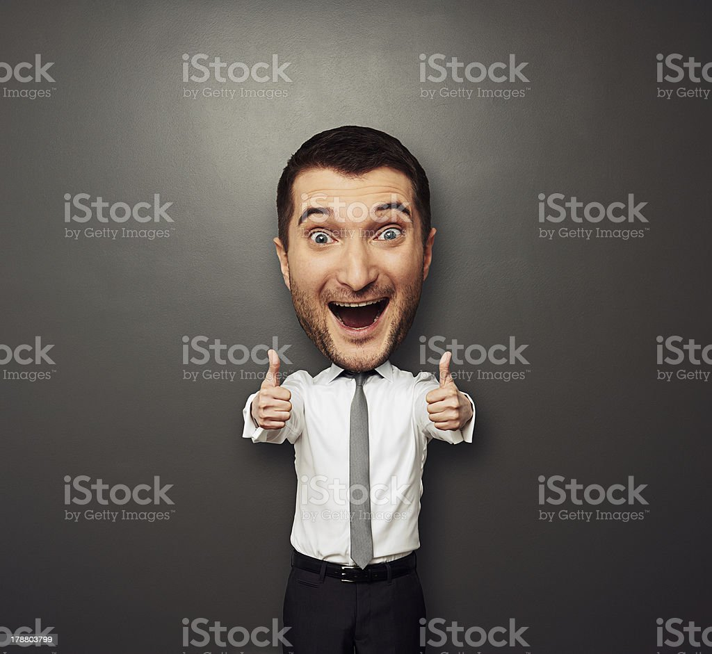 happy businessman with big head laughing stock photo