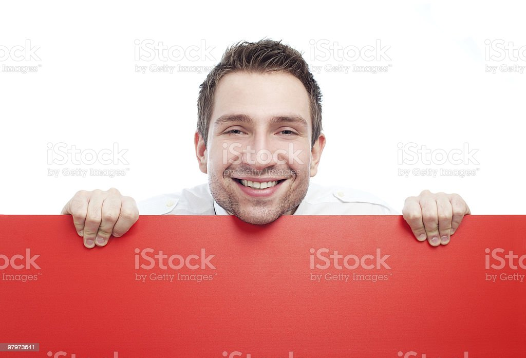 Happy businessman with blank red billboard stock photo