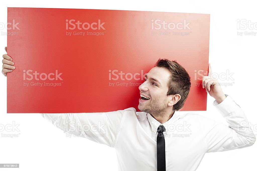 Happy businessman with blank red billboard royalty-free stock photo
