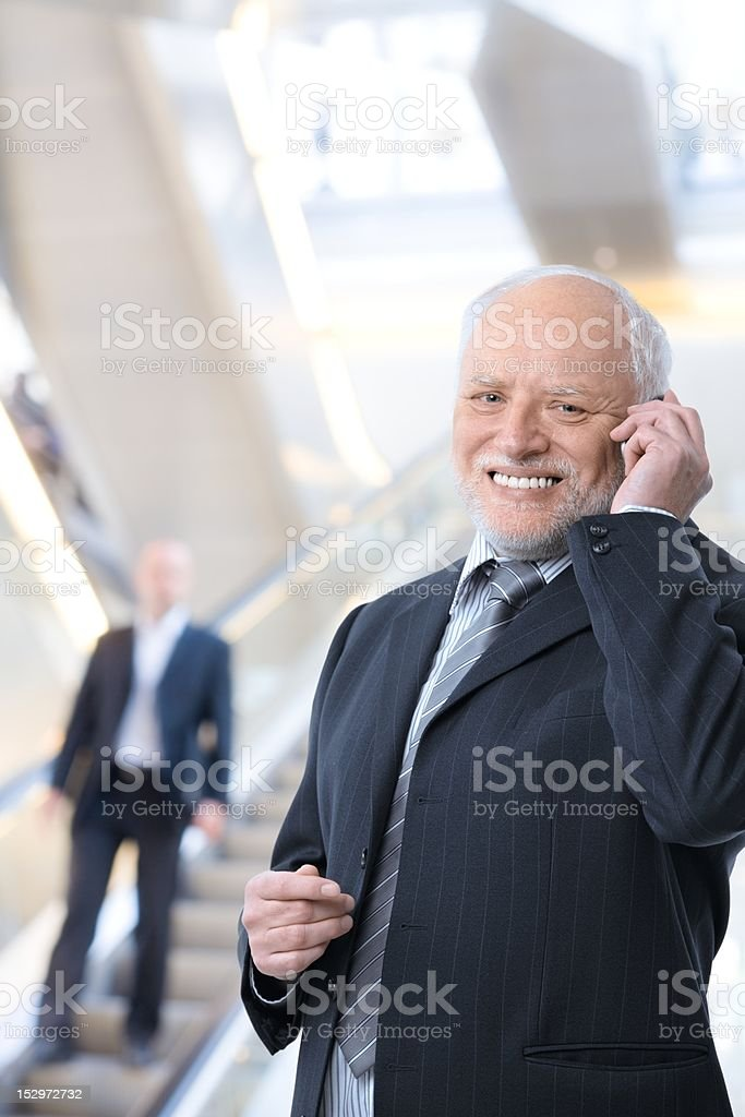 Happy businessman with cellphone royalty-free stock photo