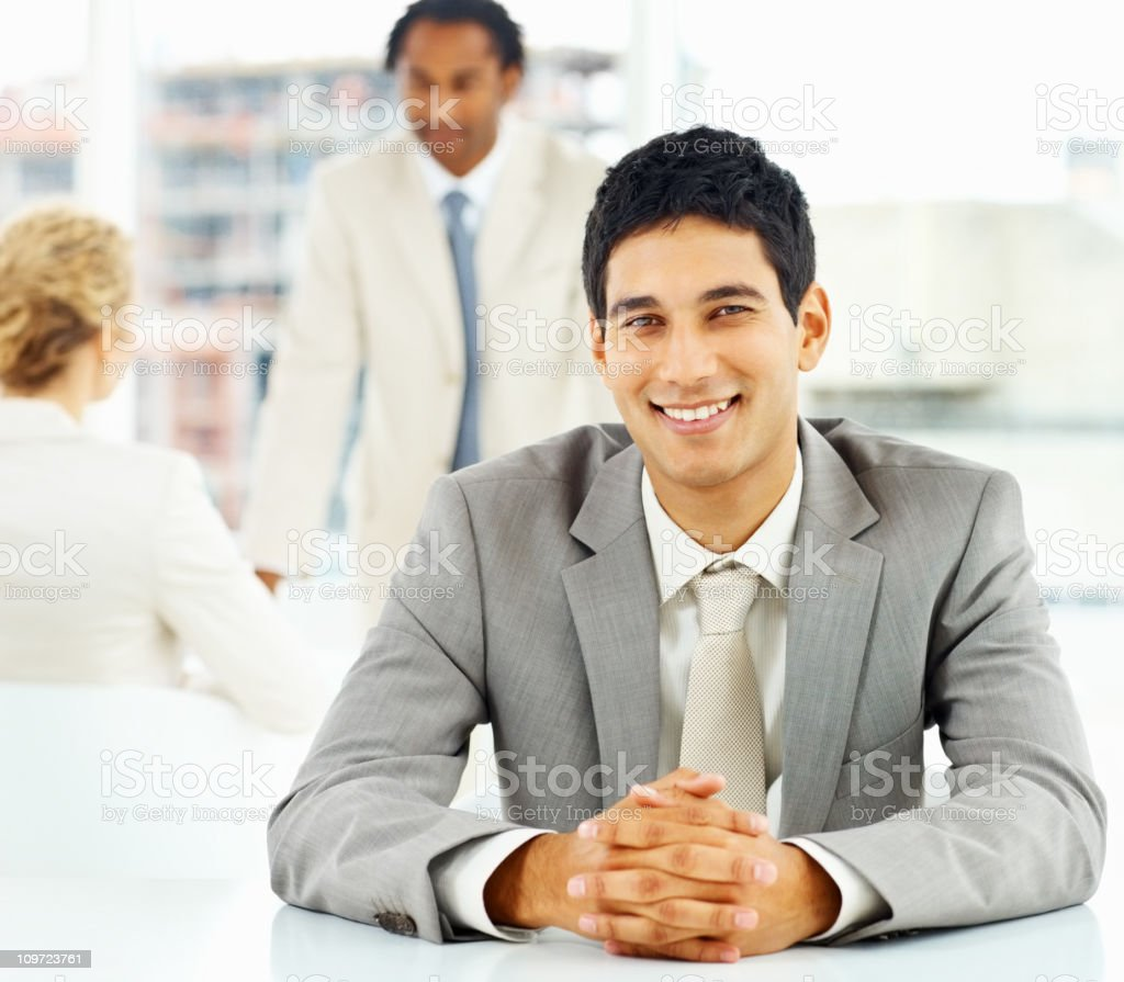 Happy businessman with colleague having conversation in the background royalty-free stock photo