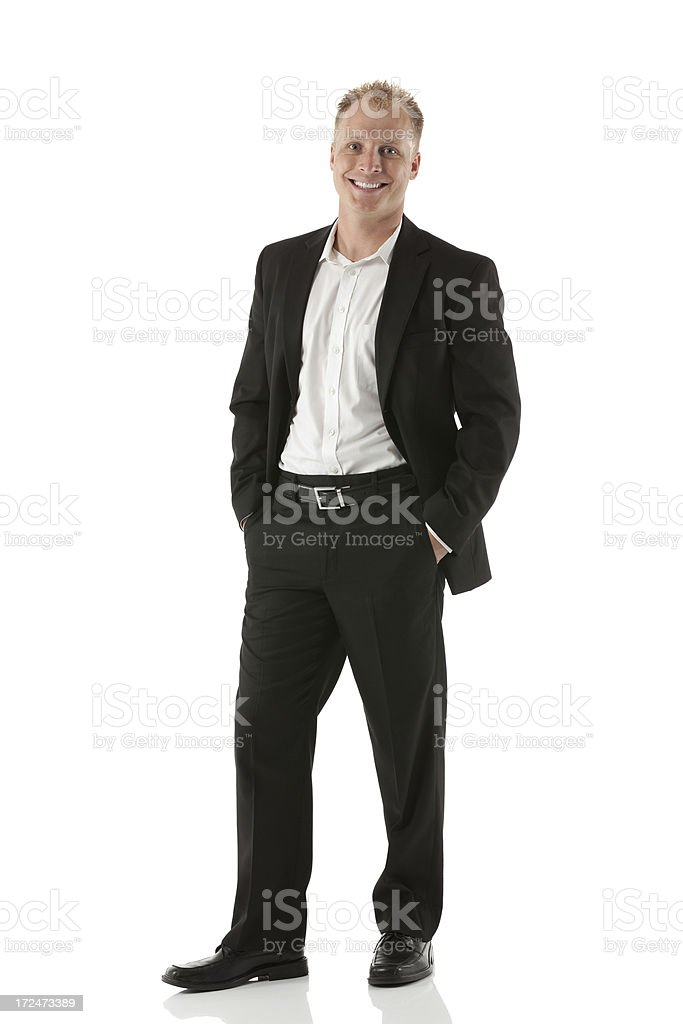 Happy businessman with hands in pockets royalty-free stock photo
