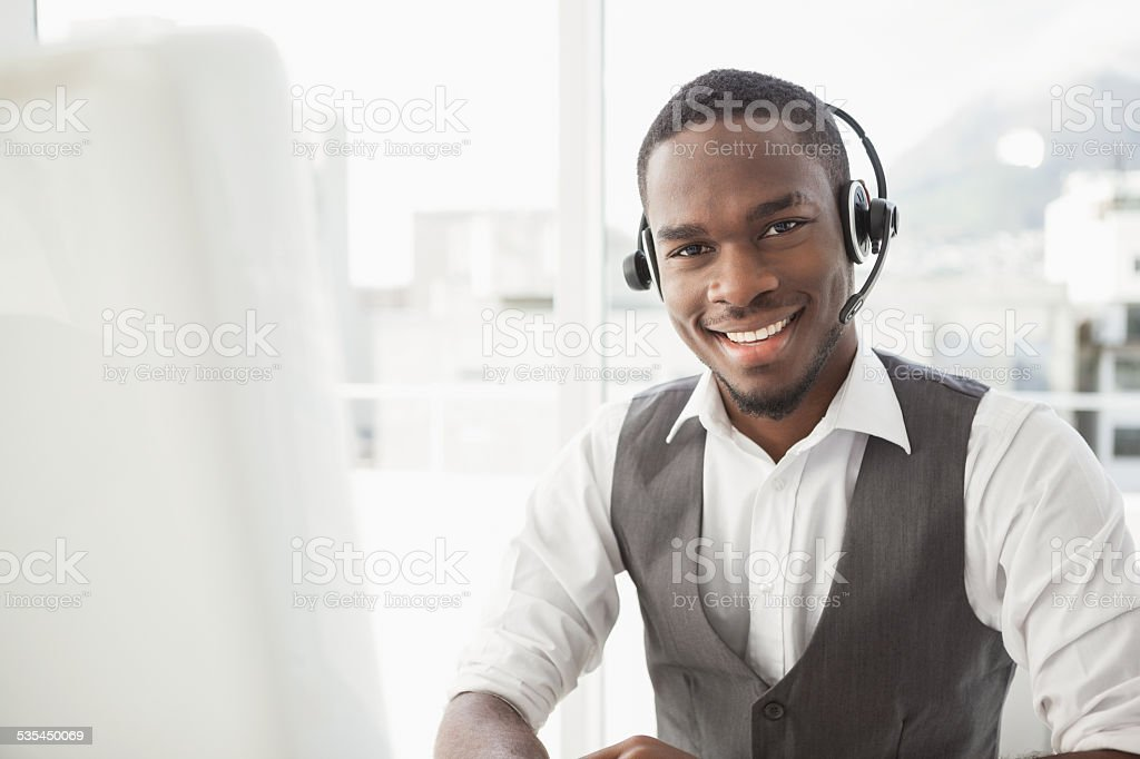 Happy businessman with headset interacting stock photo