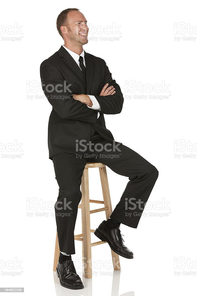 Happy businessman with his arms crossed stock photo