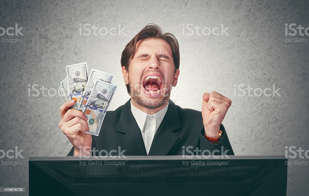 happy businessman with money in hand  and computer stock photo