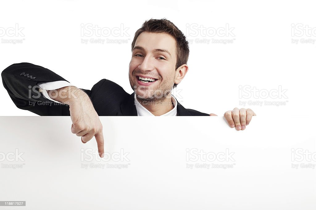 Happy businessman with sign stock photo