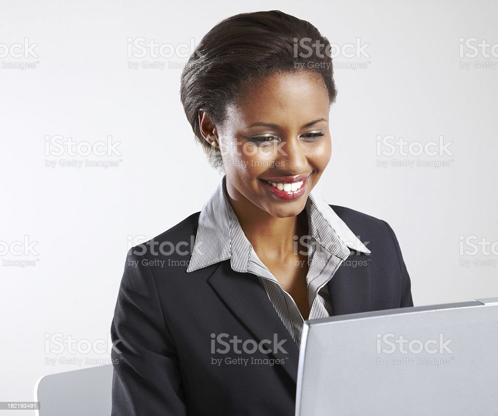 Happy businessman working on a laptop royalty-free stock photo