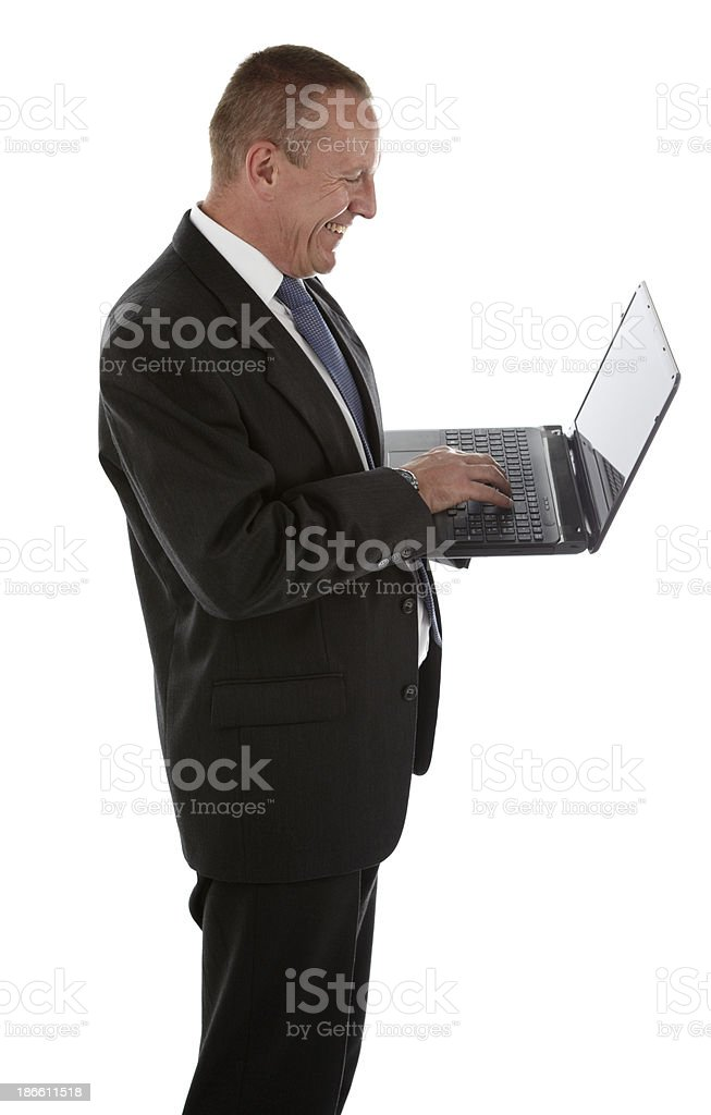 Happy businessman working on laptop royalty-free stock photo