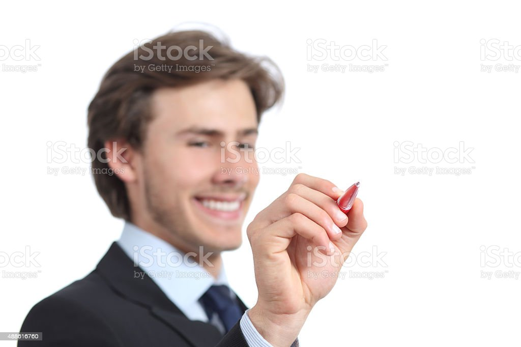 Happy businessman writing on the air with a pen stock photo