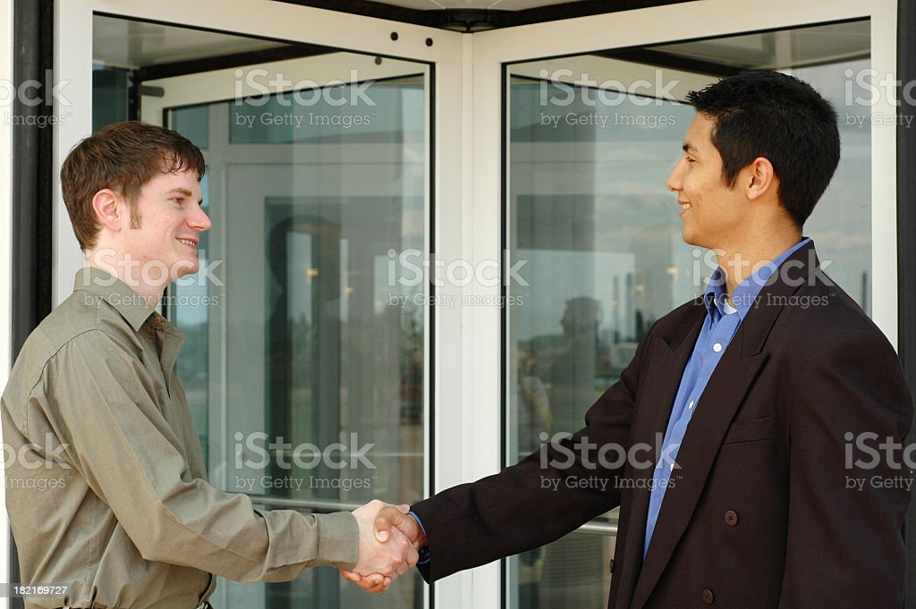 Happy Businessmen Shaking Hands royalty-free stock photo
